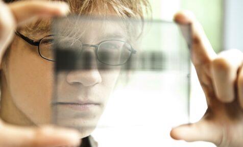 Scientist holding a glass. Estonia