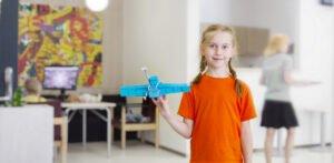 Girl. Satellite model. STEM education