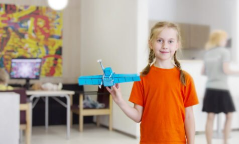 Girl and plane. STEM education