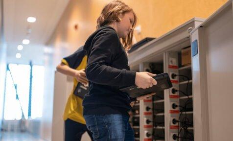 Boys at school storing computers. Education Estonia